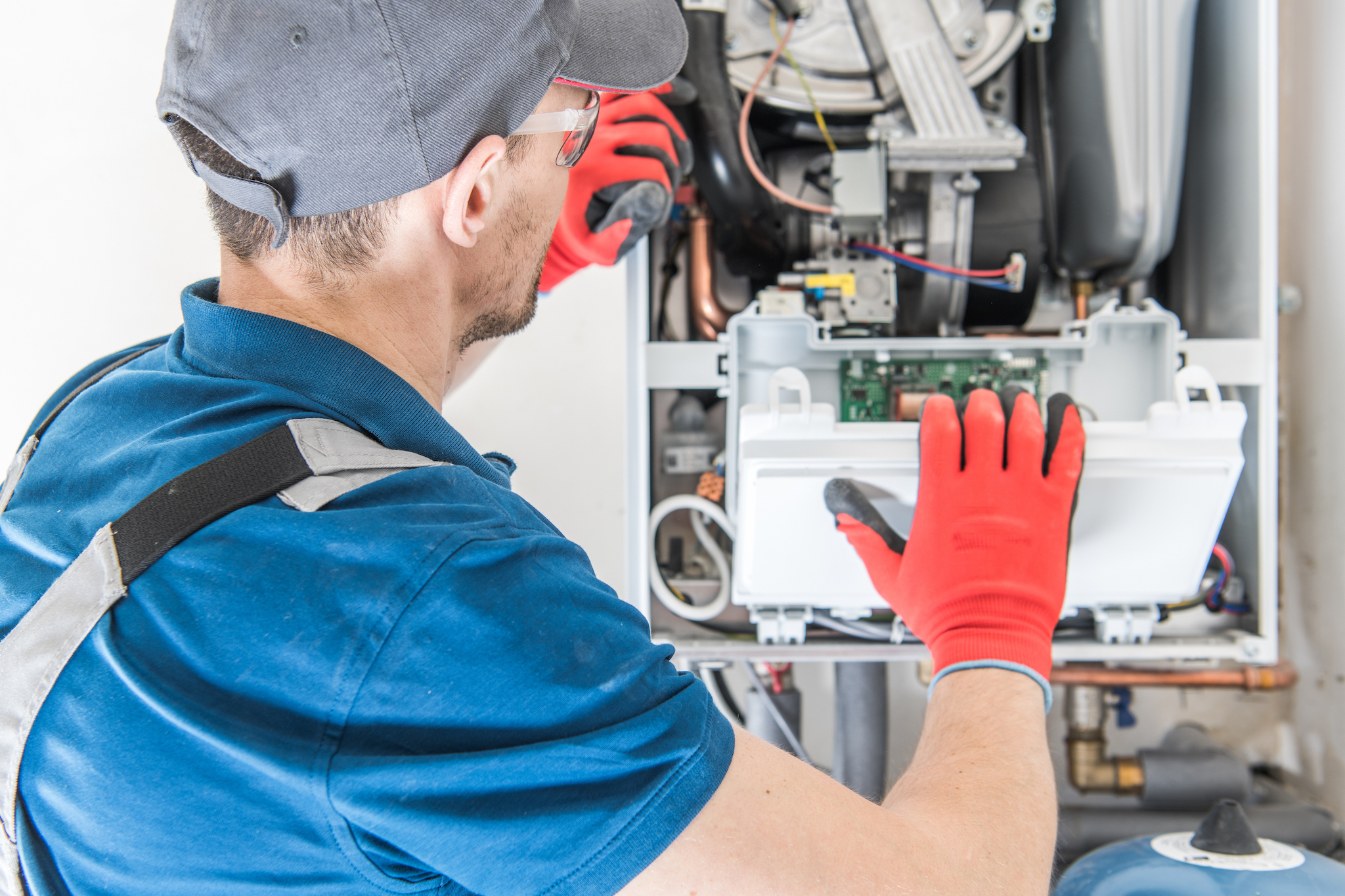 Technician is installing a boiler